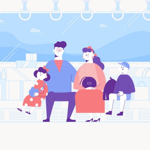 電車で移動する家族